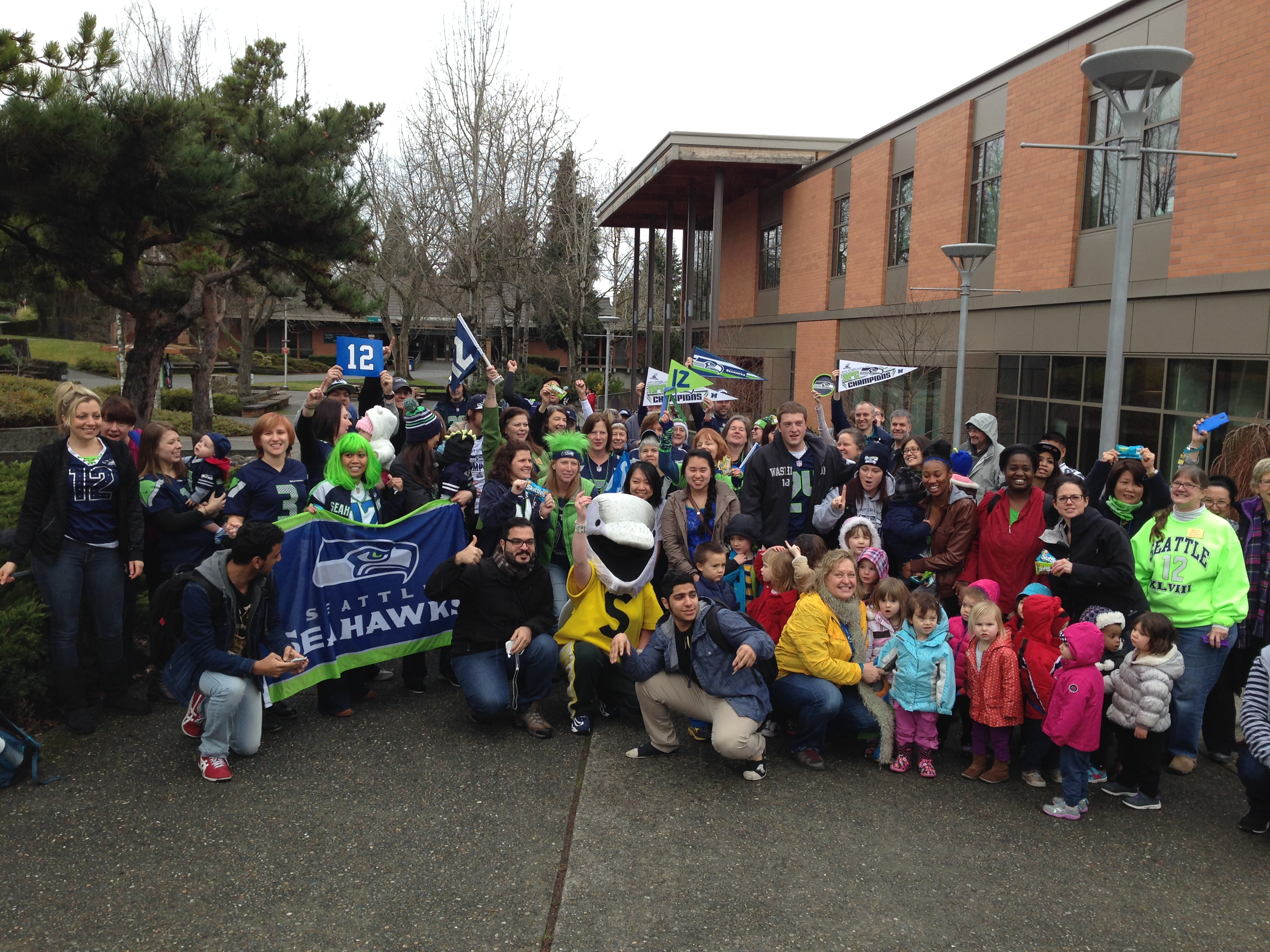 Dolphie Raises the 12th Man Flag with Shoreline Students